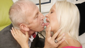 Horny young blonde sucking and fucking old dude at TopMature.nl