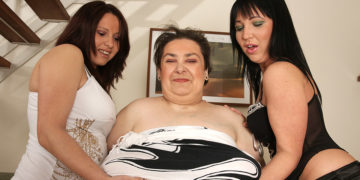 Three old and young lesbians have fun on the couch at TopMature.nl
